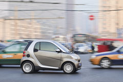 Smart car in busy traffic downtown, Beijing, China Stock Photos