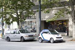 Smart car dump car Stock Photography