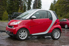 Smart Car Passion Coupe 2009. Red and silver 2009 Smart Car Passion Coupe. Sporty little smart-fortwo coupe under tow royalty free stock photography