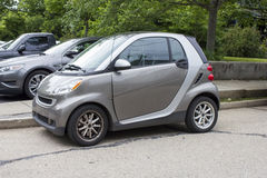 2010 Smart Car Passion Coupe. Silver 2010 Smart Car Passion Coupe.  Sporty little coupe parked on the street Stock Images