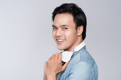 Smart casual asian man with headphone in studio background Royalty Free Stock Photo
