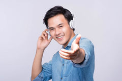 Smart casual asian man with headphone in studio background Stock Images