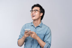 Smart casual asian man using smartphone in studio background Stock Image