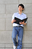 Smart Casual Looking Asian Man Reading Royalty Free Stock Images