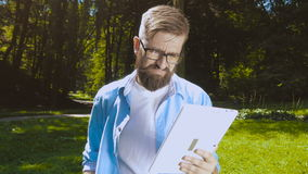 Smart casual man with digital tablet outdoors. Close up. Focus on finger. Modern remote work concept stock video