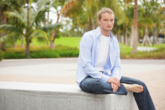 Smart casual man sitting in the park Stock Photos