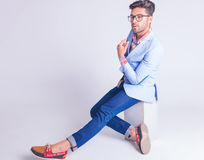 Smart casual man wearing glasses posing seated Stock Image