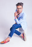 Smart casual man wearing glasses, touching his chin Royalty Free Stock Photography