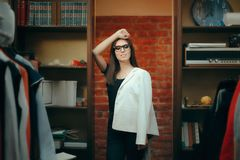 Stylish Woman Wearing a Business Formal Blazer on One Shoulder. Smart casual style lady with jacket posing relaxed royalty free stock images