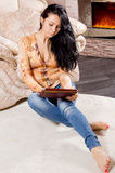 Smart casual woman working on a tablet Royalty Free Stock Image