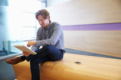 Smart casually dressed man using digital tablet Stock Photo