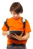 Boy occupied with tablet computer Stock Photo