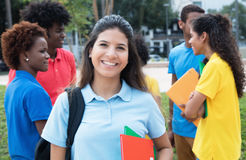 Smart caucasian female students with group of international stud Stock Images