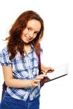 This application helps me with my homework. Smart Caucasian girl showing new application on digital tablet computer, standing isolated on white Royalty Free Stock Photos