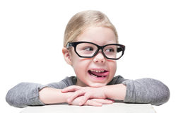 Smart cheerful beautiful little girl in glasses looking on somet Royalty Free Stock Photography