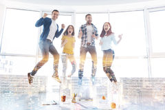 Smart cheerful students jumping together Royalty Free Stock Image