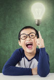 Smart child with a bright lamp Stock Photo