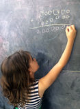 Smart child calculat and solve hard mathematic equation Royalty Free Stock Image
