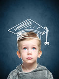 Smart child in a drawn student hat royalty free stock photos