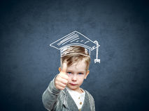 Smart child in a drawn student hat royalty free stock images