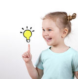 Smart child girl with light bulb isolated on white background. idea concept. school . Stock Photos
