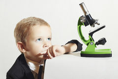 Smart child with microscope.children. schoolboy.education Royalty Free Stock Photos