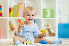 Smart child playing animal toys Royalty Free Stock Photography
