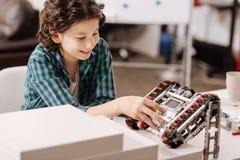 Smart child programming robot in the studio stock photo