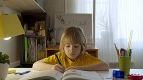 Smart child studing at home.