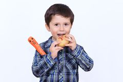 The smart child who loves to eat fresh potatoes. The boy tempted to eat his interlocutor Stock Photo