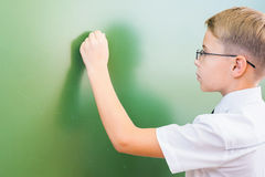 Smart child writing by left hand stock images