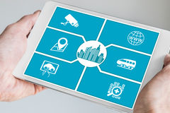 Smart city concept. Hand holding tablet or smart phone Royalty Free Stock Photo