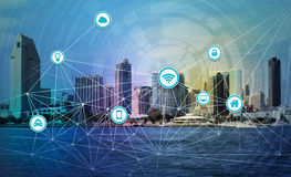 Smart city concept. An illustration of smart city internet of things concept with city skyline in the background Royalty Free Stock Images