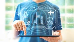 Smart city concept with man using a tablet royalty free stock image