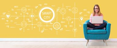 Smart city concept with woman using a laptop stock photography