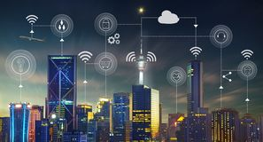 Smart city with contemporary buildings, traffic, networks. Connection and internet of things icons on top Stock Images