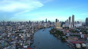 Smart city. Financial district, skyscraper buildings, and Chao Phraya River. Bangkok downtown area with blue sky at noon, Thailand. 4K cityscape VDO stock video footage