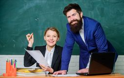 Smart and confident student. back to school. Non-formal education. paper work. office life. businessman and happy. Secretary. business couple use laptop and royalty free stock images