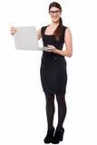 Smart corporate lady holding a laptop Stock Photo