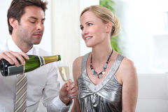 Smart couple drinking champagne Royalty Free Stock Image