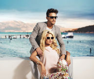 Smart couple resting in the exotic place. Smart couple relaxing in the exotic place royalty free stock photo