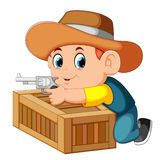 Smart Cowboy Holding His Gun And Behind The Box Royalty Free Stock Photo