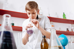 Smart curious boy spending his time in the lab Stock Photos