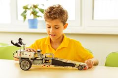 Smart cute boy preparing an engineering project royalty free stock photography