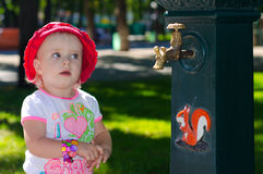 Smart Cute Girl near the Tap, Park, Outdoor Royalty Free Stock Photo