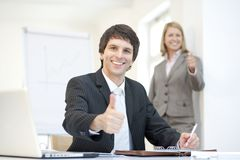 Smart dressed businessman with thumbs uo, teamwork Stock Photography