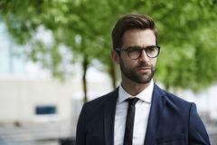 Smart dressed man. In glasses stock photos