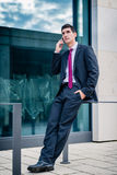 Smart dressed man talking in phone Stock Images