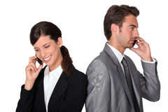 Smart duo on cell phone Royalty Free Stock Photos