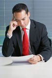 Smart eurasian business man browsing documents Royalty Free Stock Photo